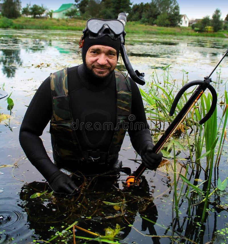 Man with fishing harpoon stock image. Image of