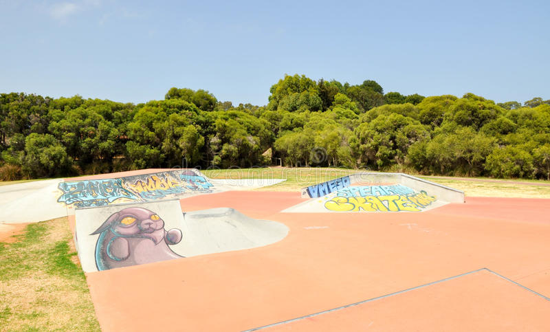Spearwood Skate Park Ramps. SPEARWOOD,WA,AUSTRALIA-JANUARY 5,2016: View of skate ramps with urban art and tagging at Spearwood Skate Park in Spearwood, Western royalty free stock image