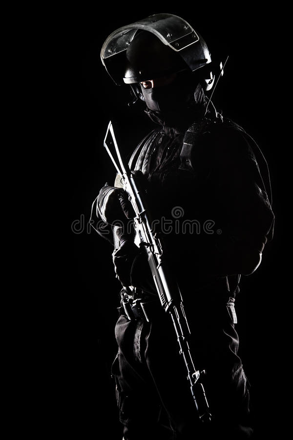 Spec ops. Contour shot of spec ops soldier on black background stock photo