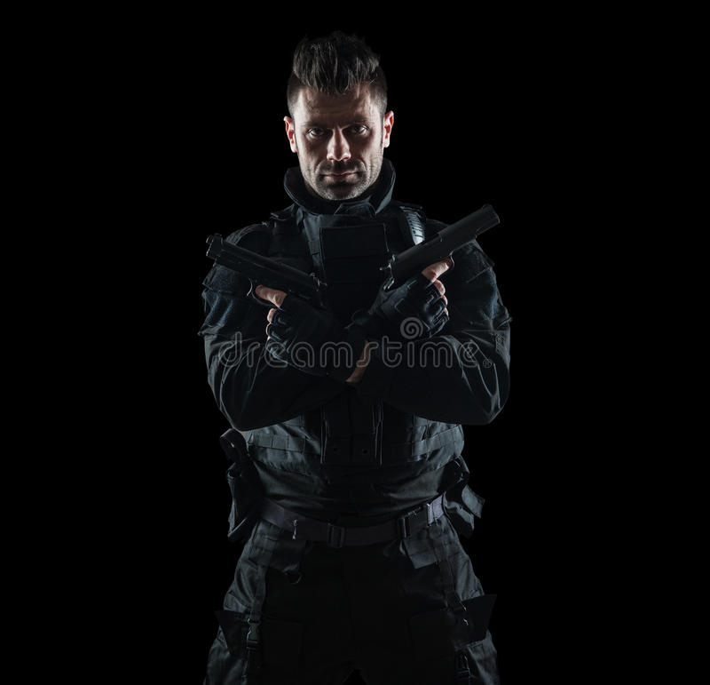 Spec ops police officer SWAT in black uniform studio royalty free stock images