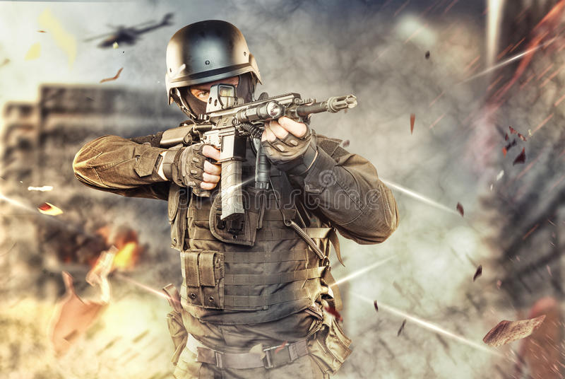 Spec ops police officer SWAT in black uniform studio stock photography