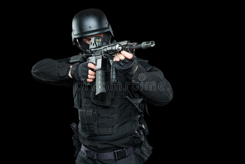 Spec ops police officer SWAT in black uniform studio stock images