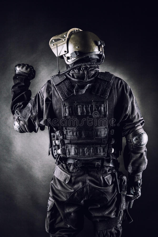 Spec ops. Soldier on black background shot from behind royalty free stock photo