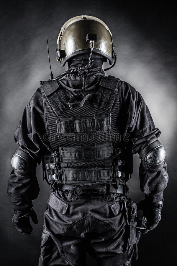 Spec ops. Soldier on black background shot from behind stock images