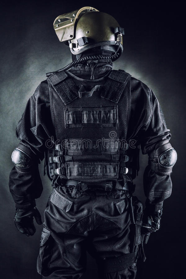 Spec ops. Soldier on black background shot from behind stock image