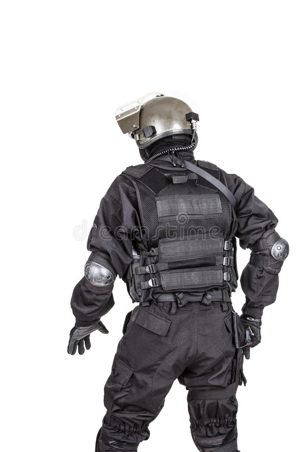 Spec ops. Soldier in black uniform and face mask shot from behind royalty free stock photo