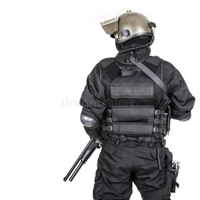 Spec ops. Soldier in black uniform and face mask shot from behind royalty free stock photos