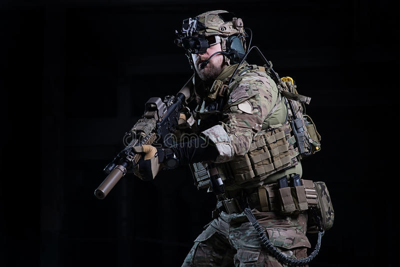 Spec ops soldier with gun stock images