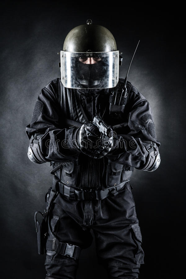 Spec ops. Soldier in uniform on black background royalty free stock photo