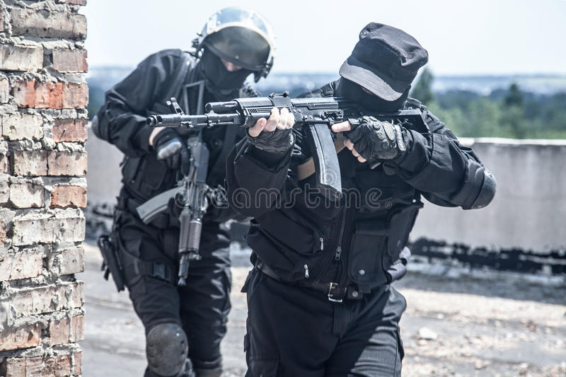 Spec ops soldiers. Two spec ops soldiers in black uniform in action stock image
