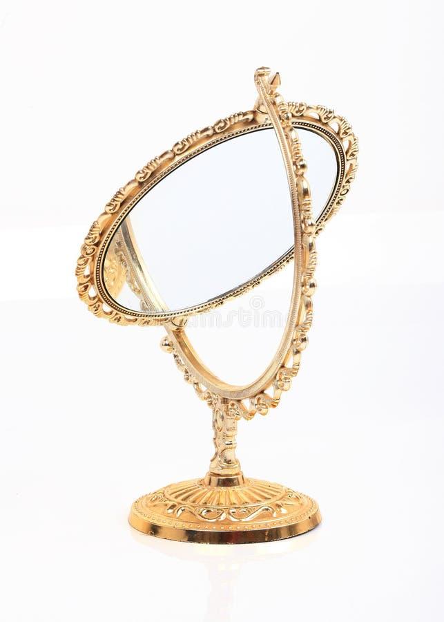 Specchio dorato di trucco isolato fotografie stock