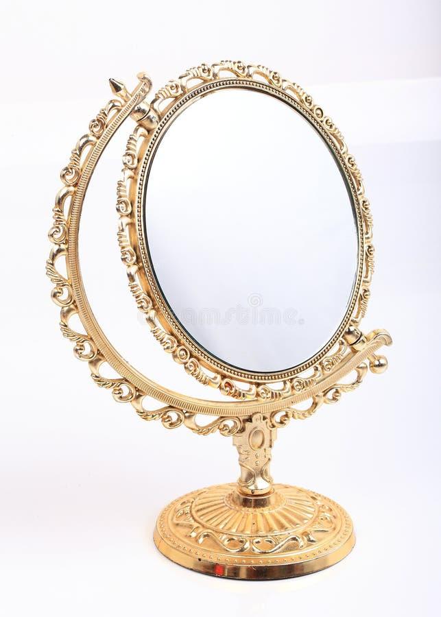 Specchio dorato di trucco isolato immagini stock