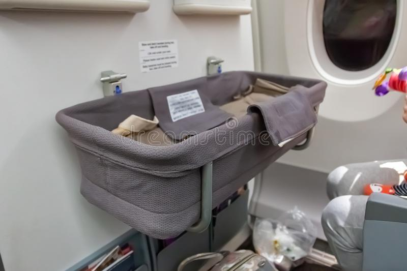 Special baby bassinet in the airplane. Infant safety during the flight.  stock photos