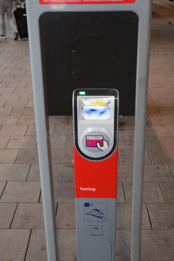 Special card reader to pay for surtax or supplement on the fee to travel with the intercity direct on Rotterdam Central to Amsterd royalty free stock photography