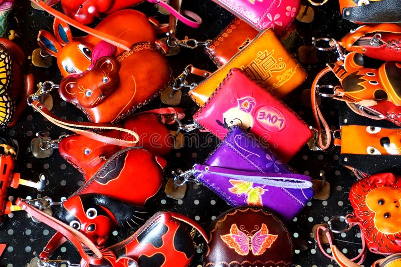 Special, colourful, and funny handmade leather bags art toys royalty free stock photo