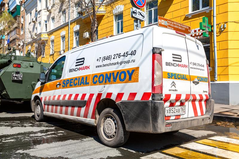 Special convoy vehicles on city street. Samara, Russia - May 4, 2019: Special convoy vehicles on city street during the transportation of heavy army technics royalty free stock image