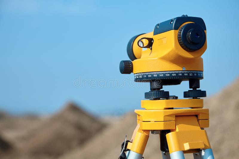 Special device level for surveyor builders, geodesy equipment close up. Outdoors, copy space stock photo