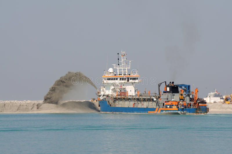 Special dredge ship. Pushing sand to create new land in Dubai, United Arab Emirates royalty free stock images