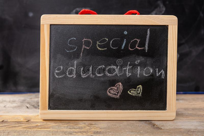 Special education drawing on blackboard with frame stock images