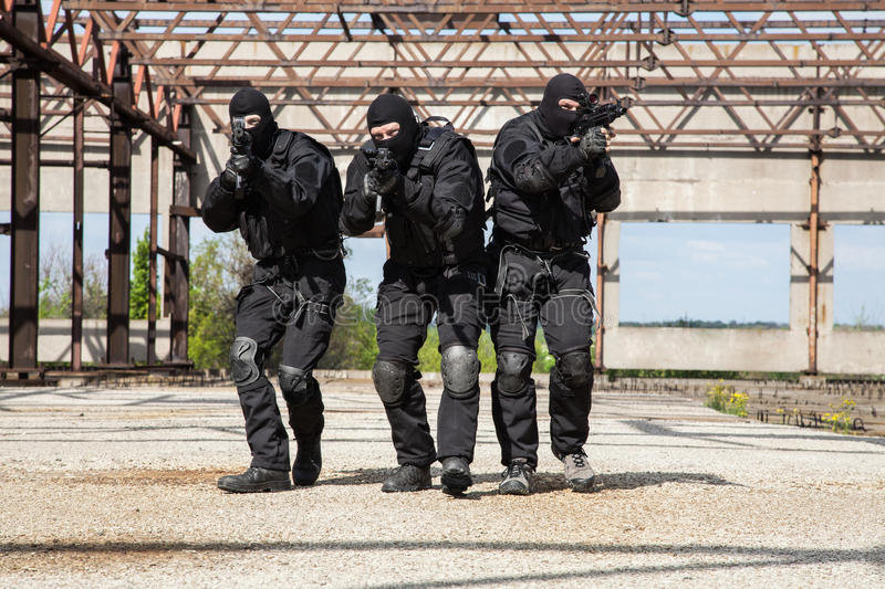 Special forces in action. Special forces operators in black uniform in action royalty free stock photos