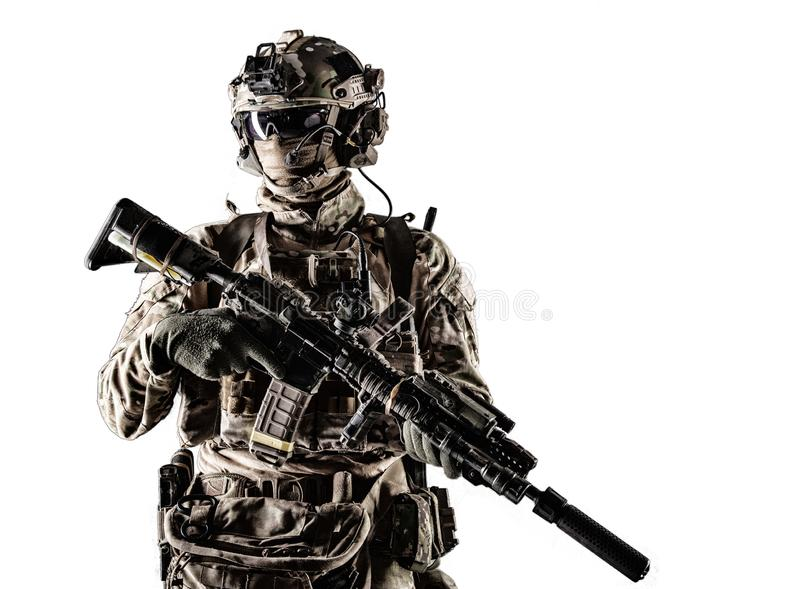 Modern army armed ranger isolated studio portrait. Special forces fighter in battle uniform and helmet with radio headset, face mask and ballistic glasses stock images