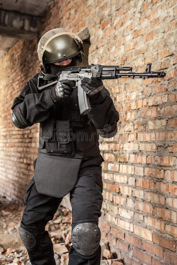Special forces operator. In black uniform and bulletproof stock photos