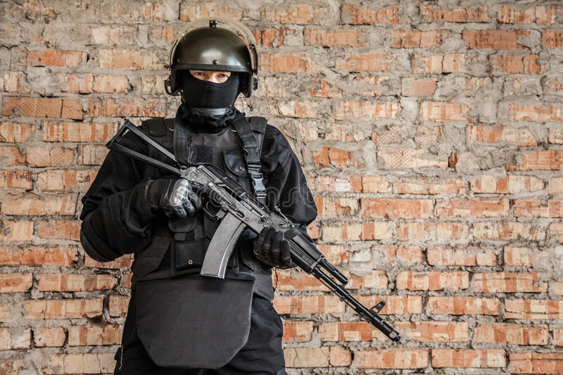 Special forces operator. In black uniform and bulletproof royalty free stock photo