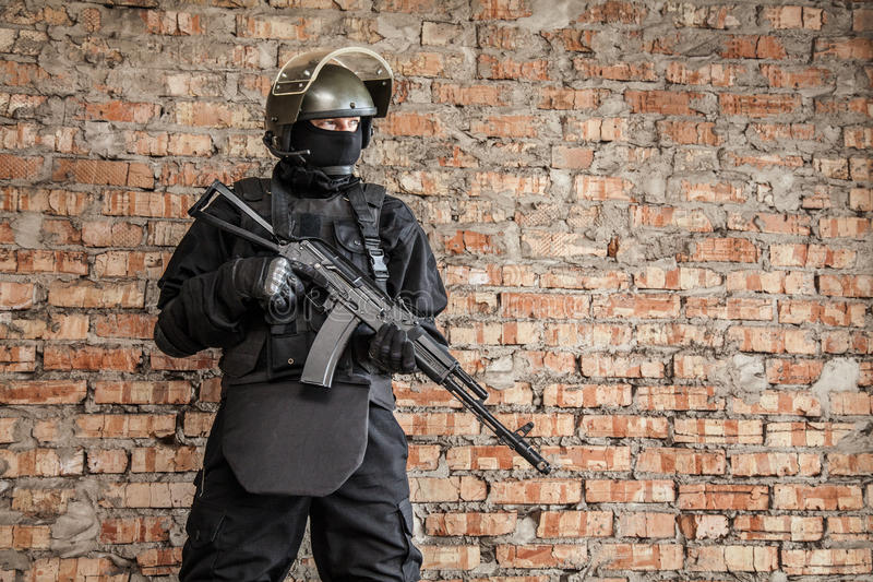 Special forces operator. In black uniform and bulletproof royalty free stock photos