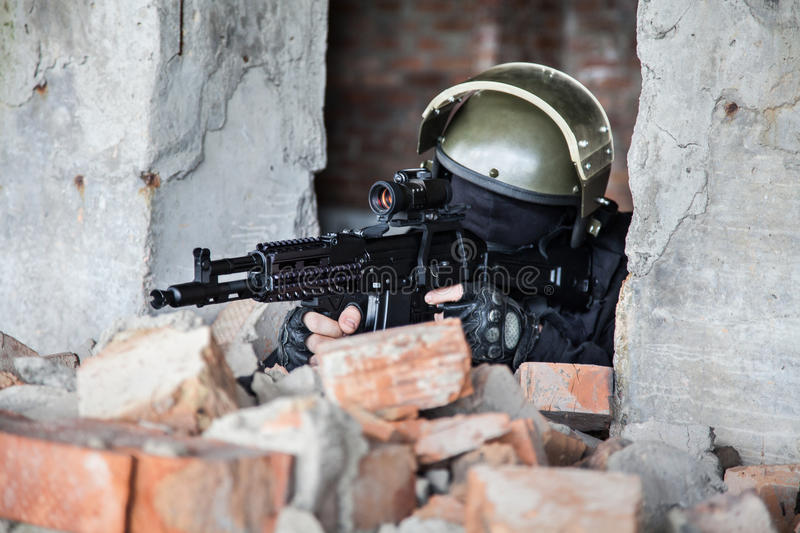 Special forces operator. In black uniform and bulletproof royalty free stock images
