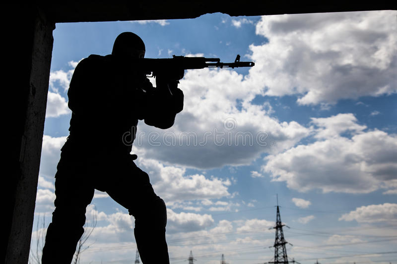 Special forces operator. In black uniform and bulletproof stock photography