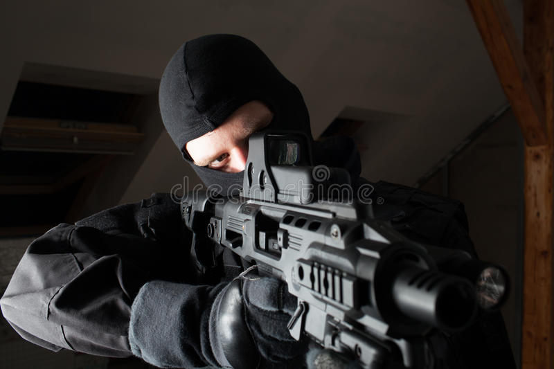 Special forces soldier is aiming and shooting on the target royalty free stock photography