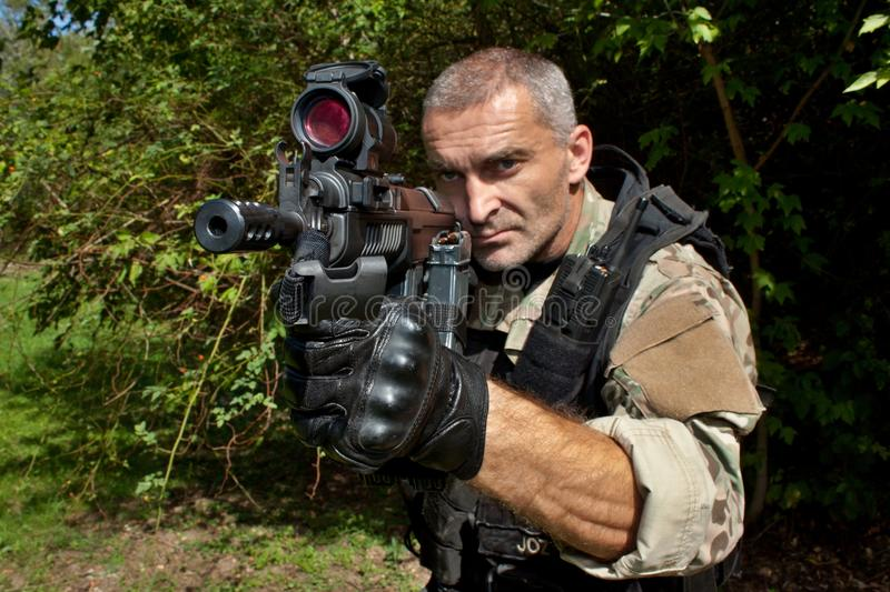 Special Forces soldier with an assault rifle. Sa.58 stock image