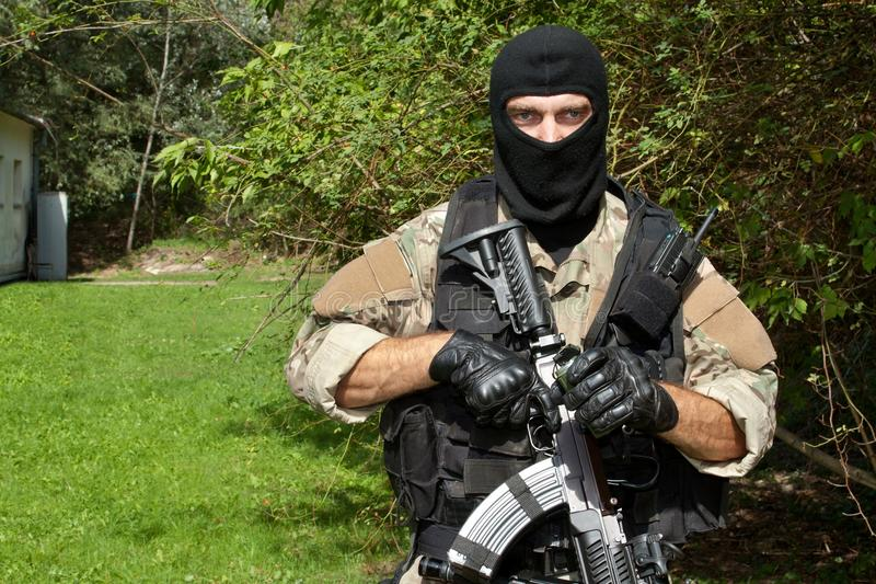 Special Forces soldier with an assault rifle. Sa.58 stock photos