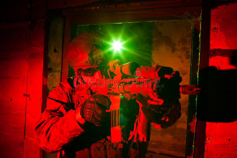 Special forces soldier or contractor during night mission. Special forces soldier or private military/security contractor during night mission/operation (red and royalty free stock photo