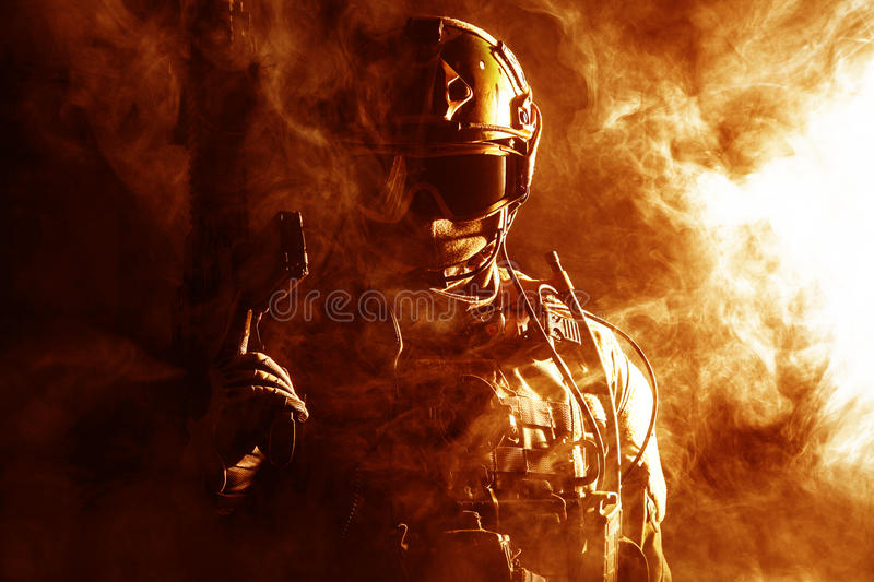 Special forces soldier in the fire stock images
