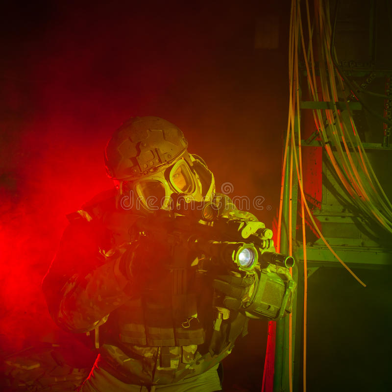 Special forces soldier with gas mask during night mission. Special forces soldier/ anti-terrorist unit policeman with gas mask during the night mission/special stock photo