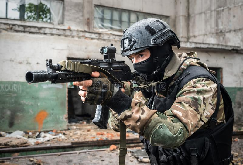 Special Forces soldier with gun. The Special Forces soldier with gun royalty free stock images