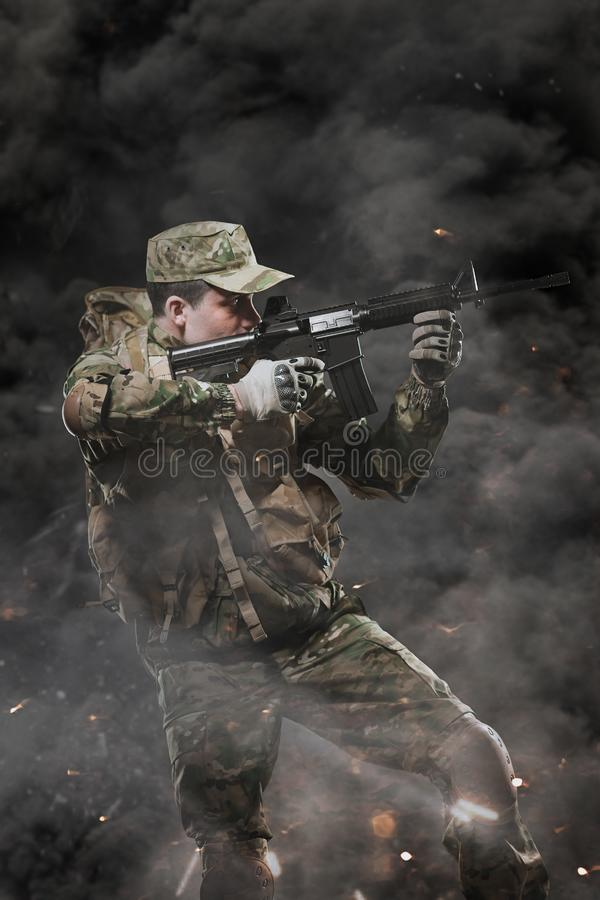 Special forces soldier man hold Machine gun on a dark background. Military, war, conflict, soldiers - Special forces soldier man hold Machine gun on a dark stock photo