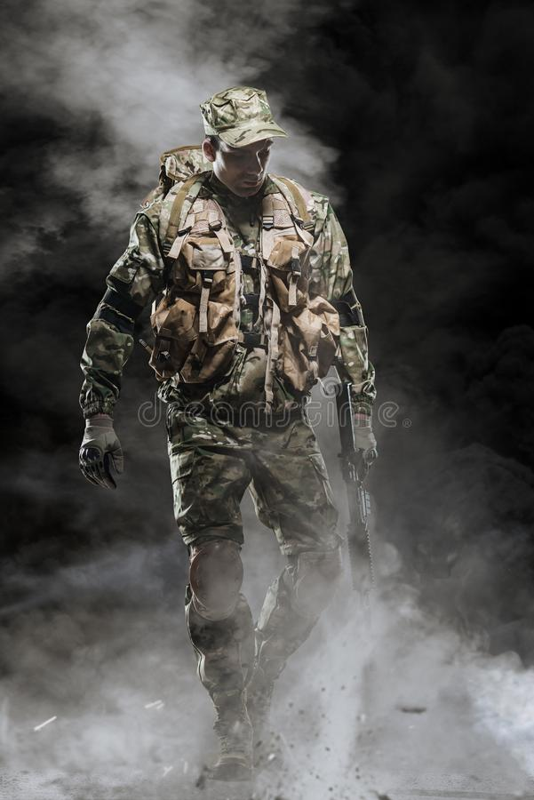 Special forces soldier man hold Machine gun on a dark background. Military, war, conflict, soldiers - Special forces soldier man hold Machine gun on a dark royalty free stock photography