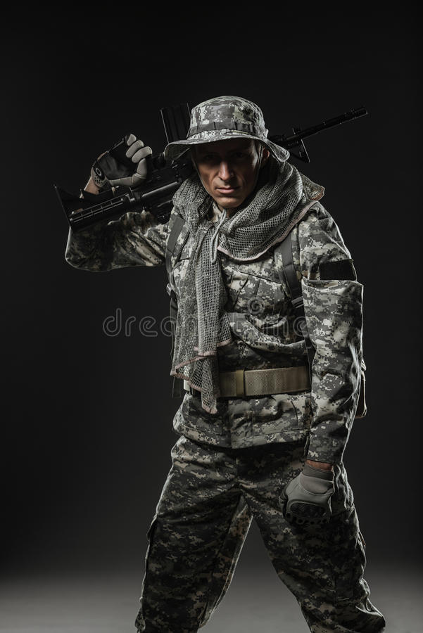Special forces soldier man with Machine gun on a dark background. Military, war, conflict, soldiers - Special forces soldier man hold Machine gun on a dark royalty free stock photography