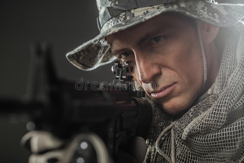 Special forces soldier man with Machine gun on a dark background. Military, war, conflict, soldiers - Special forces soldier man hold Machine gun on a dark royalty free stock photo