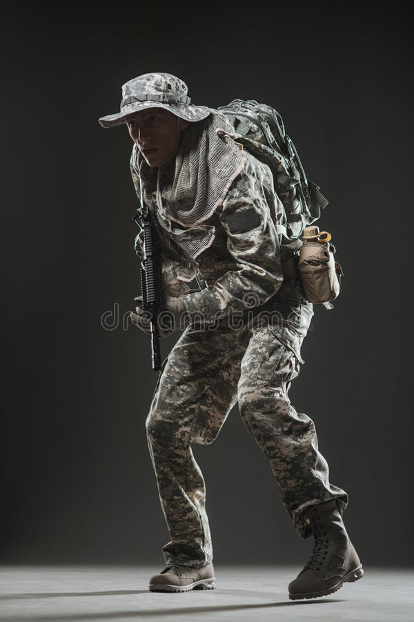 Special forces soldier man with Machine gun on a dark background. Military, war, conflict, soldiers - Special forces soldier man hold Machine gun on a dark stock images