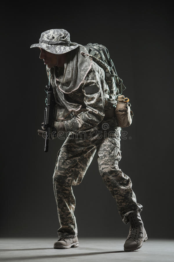 Special forces soldier man with Machine gun on a dark background. Military, war, conflict, soldiers - Special forces soldier man hold Machine gun on a dark royalty free stock image