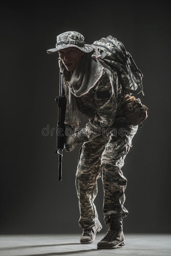 Special forces soldier man with Machine gun on a dark background. Military, war, conflict, soldiers - Special forces soldier man hold Machine gun on a dark royalty free stock images