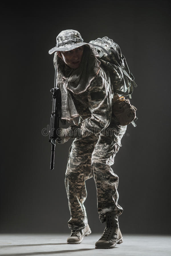 Special forces soldier man with Machine gun on a dark background. Military, war, conflict, soldiers - Special forces soldier man hold Machine gun on a dark stock photos