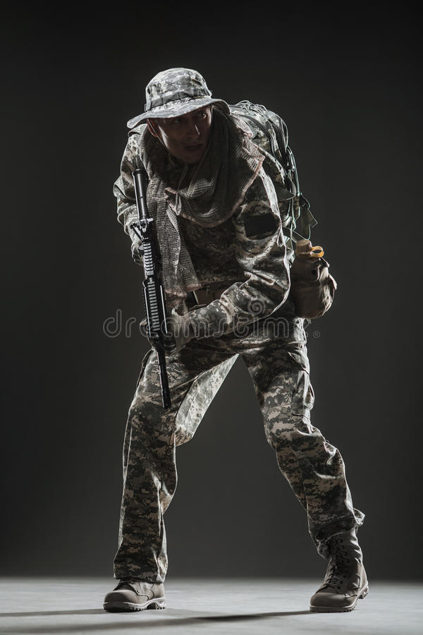 Special forces soldier man with Machine gun on a dark background. Military, war, conflict, soldiers - Special forces soldier man hold Machine gun on a dark royalty free stock photos