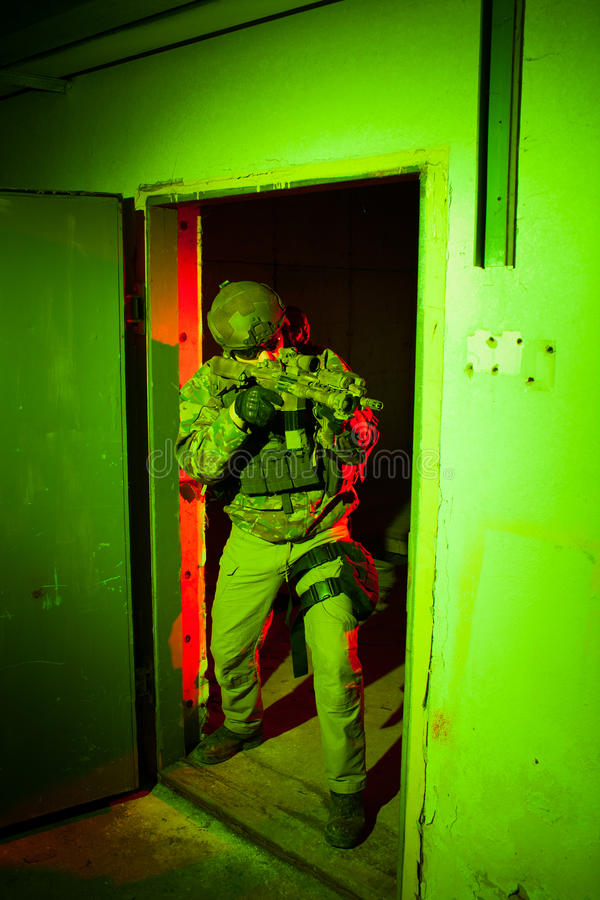 Special forces soldier during night mission. Special forces soldier/anti-terrorist unit policeman or private military/security contractor during night CQB royalty free stock photo
