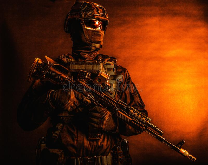 Special forces soldier posing with service rifle stock photos