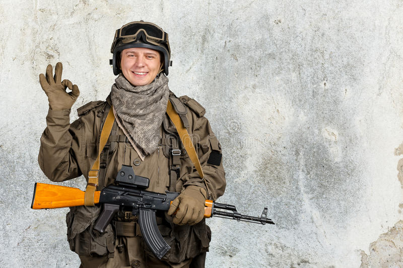 Special forces soldier. With rifle stock photos