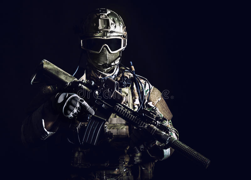 Special forces soldier. With rifle on dark background royalty free stock images